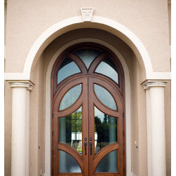 Custom Wood Doors - Custom wood doors made out of hand made solid mahogany wood with clear glass impact approved or safety glass with a custom design for the doors and transom!