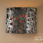Alita, 1 Lt Wall Sconce - Aged black metal with rust accents.