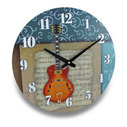 Zeckos - Acoustic Guitar and Sheet Music Decorative Wooden Wall Clock 15 In. - This 15.5 inch diameter (39 cm) wall clock features a printed image of a classic acoustic guitar on a decorative background of sheet music and swirls that would look amazing on the wall in a living room, bath, bedroom or a music themed room. This pressed wood wall clock boasts large easy to read numbers and hands, and requires just 1 AA battery (not included) accessible from the back. It's wonderful as a housewarming gift any music lover is sure to admire