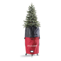 Grandin Road - Slim TreeKeeper Storage Bag - First, attach the TreeKeeper to your tree stand, where it poses as a simple tree skirt. When it's time to store, open the tree skirt, grab the built-in handles, and pull it up to compress your hinged tree, making it easy to move and store. Next season, set-up is as simple as unfastening the top zippers and straps and pulling down the bag. Our innovative TreeKeeper Storage Bag makes packing up your Christmas tree incredibly easy. Sturdily crafted from a rugged blend of polyester and nylon, this convenient holiday storage bag will stand up to years of wear. Store your tree in just three easy steps:. . . . A Grandin Road exclusive.