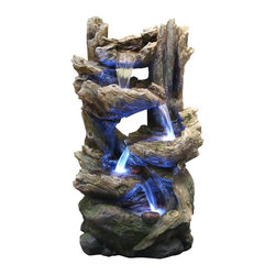 Alpine Fountains - Flowing Fountain w LED Lights - Made from resin, stone powder and fiberglass. 1 Year Limited Warranty. Assembly Required. Overall Dimensions: 21 in. L x 18 in. W x 38 in. H (48.4 lbs)Our newest rainforest waterfall fountains have the look of natural stone and wood with the strength of fiberglass.  The different tiers create multiple water flows that offers a relaxing and meditative environment. Can be placed indoors or out.