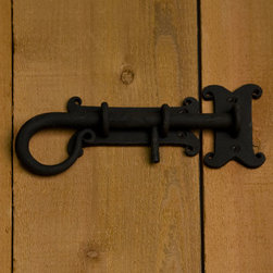 Decorative Iron Sliding Bolt - This sliding bolt made of solid iron and is ideal for securing your outdoor gate. With its curved handle and decorative mounting plates, it will certainly add a little rustic charm to your home.
