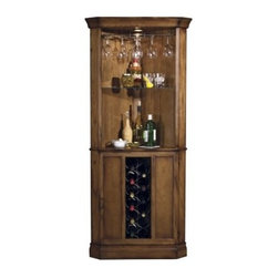 Howard Miller Piedmont 13 - Bottle Wine Storage Bar - What We Like About the Piedmont Wine Bar:This wine bar takes advantage of the often unused corner that every home has. The corner design of the wine bar offers a broad opening to store and reach your spirits or wine. The fairly simple design of the wine bar assures it will fit into most decoration styles. The unique design of the lower door has three panels two of wood and one of glass. The center glass panel covers the tall slim wine rack and is flanked by the two solid panels which hide two small storage areas each with a fixed shelf. Because it is designed for the corner the Piedmont Wine Bar is equipped with floor levelers to accommodate carpet wood or vinyl flooring.The Howard Miller StoryIncomparable workmanship unsurpassed quality and a quest for perfection - these were the cornerstones of the company Howard C. Miller founded back in 1926 at the age of 21. Even then Howard Miller understood the need to create products that would be steeped in quality and value.In 1989 Howard Miller began creating collectors' cabinets with the same attention to detail and craftsmanship inherent in their clock-making. Fashioned from glass and hardwoods Howard Miller cabinets are ideal for displaying heirlooms plates glassware and other collectibles.A highly respected brand Howard Miller maintains its popularity because of the company's commitment to quality. Every product manufactured at the company's sprawling facility in Zeeland Michigan undergoes stringent tests and exceeds industry standards to ensure a lifetime of enjoyment.