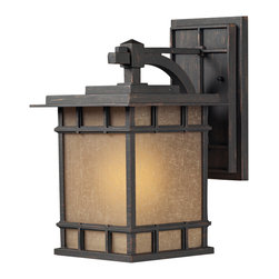 Elk Lighting - EL-45011/1 Newlton 1-Light Outdoor Sconce in Weathered Charcoal - The Newlton Collection projects clean styling and historic character that is carried through the design elements of the frame, arm and backplate. The lantern is constructed of solid cast aluminum, finished in weathered charcoal for long lasting durability. The seeded amber linen glass portrays a warm ambiance to your outdoor environment.