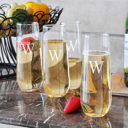 None - Personalized Stemless Champagne Flutes (Set of 4) - Celebrate your next big event in style by using these custom stemless champagne flutes. This set of four flutes can be engraved with a single letter at no additional cost,which saves you money and makes a great housewarming or wedding shower gift.