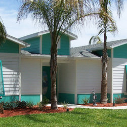 Bahamas Shutters - These Bahamas shutters have the Open Louver Style (louvers are at a 45 degree angle) which allow maximum visibility when the shutters are propped open at a 45 degree angle.  (These are at approximately 15 degree angle.)