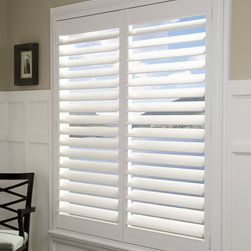 Hunter Douglas® Plantation Shutters - St. Louis - This window has been beautifully dressed with Hunter Douglas Composite Shutters in 4 1/2'' louvers, hidden tilt, and outside mount. Shutters bring the finishing touch to any window.