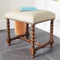 European Barley Twist Stool - Crafted in the style of 17th-century Spanish design, this stool is constructed from acacia wood. The spindle base is first handcarved, then finished with a French polish technique. The cushion is upholstered in natural khaki linen and trimmed with large brass studs. When your dogs are barking, this is a handsome stool to rest them on. Wisteria