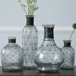 Wire Bottle Bud Vase - Flowers are an easy way to bring the outdoors in. These simple and somewhat industrial-feeling bud vases are visually interesting but won't distract from the arrangement placed inside.