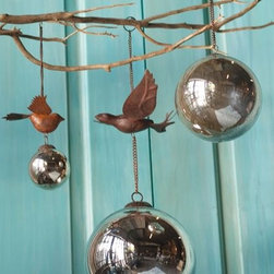 Antiqued Mercury Bird Ornament - This garden ornament is a great mix of new and antique materials. The mercury glass balls make the sculpture with it's vintage look and shine.