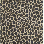 Giraffe Outdoor Rug - A black and gold giraffe rug is a great contrast to the offwhite settee, and comes in a handy size for your small space!
