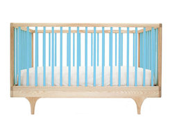 """Kalon Studios - Kalon Studios Caravan Crib Blue - Kalon Studios designs nursery furniture with a focus on contemporary form, innovative style and sustainability. Inspired by a storybook circus wagon, the Caravan crib offers playful and modern elements. This minimalist baby furnishing features blue slatted sides, two adjustable mattress heights and the option to convert to a platform toddler bed. Made in the USA from FSC-certified maple and low VOC, HAPs-free paint. Due to handmade and natural quality, slight color and grain variation may be present. 54.5""""W x 30""""D x 34""""H. Fits standard crib mattress (not included). Conforms to ASTM, CPSC and Health Canada regulations. Glue contains zero formaldehyde and exceeds European E1 and California emission standards by 3 times. Green guard certified."""