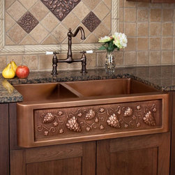 "33"" Tuscan Series 60/40 Offset Double-Bowl Copper Farmhouse Sink - Bring the feel of Tuscany to your kitchen with this grape motif farmhouse sink, featuring two different sized wells."