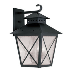 """Livex Lighting - Livex Lighting 2676 Montgomery Large 21 Inch Tall Outdoor Wall Sconce - Livex Lighting 2676 Montgomery Three Light Outdoor Wall SconceFeaturing a prominent workman style design, the Montgomery three light top mount outdoor wall sconce features a simple rustic kerosene lamp design with a perforated chimney, four sided roof, and clear seedy glass with """"x"""" shaped guards. This arts and crafts style light will enhance the look of any outdoor decor.Livex Lighting 2676 Features:"""