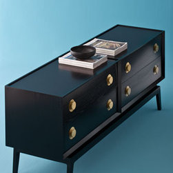 "Jonathan Adler - Sleek, with both a contemporary and retro feel, the ""Claude"" Four-Drawer Chest will be a wonderful addition to your modern decor.    * Available in white with polished nickel accents or black with brass accents.    * 65""W x 17""D x 24.5""T."