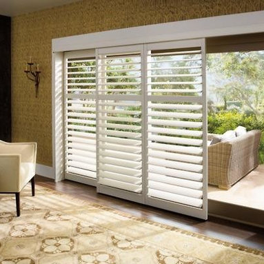 Sliding Glass Door Treatment - Hunter Douglas Palm Beach™ Polysatin shutters are constructed with UV resistant vinyl, so they're guaranteed never to warp, crack, fade, chip, peel or discolor, regardless of extreme heat or moisture. This is a great treatment for a sliding glass door!