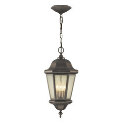 Murray Feiss - Murray Feiss Martinsville Transitional Outdoor Hanging Lantern X-BC1195LO - The Martinsville Transitional Outdoor Hanging Lantern features both a durable construction as well as a timeless aesthetic. The simple lines combined with a traditional Corinthian Bronze finish makes this the ideal outdoor light fixture. The Clear Seeded Glass is framed perfectly by the Lanterns hexagon shape, emitting a glow so beautiful you might feel guilty leaving it outside.