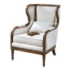 Neylan Wing Chair - A blend of beauty and comfort make this chair ideal for placement facing a warm fireplace, within a sitting area in a master suite, or as additional seating in a great room. The Neylan Wing Chair boasts a solid pine frame in a weathered walnut finish accented with individually hammered, antique brass nails. The seat cushion, backrest, and sides feature a soft neutral linen; the pillow reverses to a pale beige stripe.