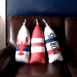 Maine Lobster Buoy Pillow by Cobalt Sky Studio - Oh buoy! Hanging on the wall or sitting on a chair or bed, these buoy pillows are reminiscent of salt and surf. They can be personalized with names or dates too.