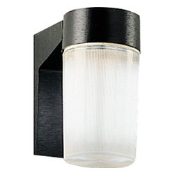 """Progress Lighting - 7W Hard-Nox Compact Fluorescent Outdoor Wall Lantern - Energy efficient, long-lasting lamps. White polycarbonate diffuser. Can be wall mounted. 120V NPF ballast. UL listed for wet locations. When shopping for outdoor lighting, be sure to select a design and size to complement your house while providing sufficient lighting for safety. Features: -Cast aluminum wall bracket. -UV stabilized polycarbonate ribbed diffuser. -Diffuser screws into aluminum bracket. -Wall mounted. -Covers any outlet box. -Outlet box mounting strap provided for center lock up mounting. -Standard Black finish with a clear prismatic diffuser. -G23 base sockets, NPF ballast. -120V ballasts. -HPF available on request. -Minimum start temperatures - 0 F. -UL-CUL wet location listed. -Width/Diameter: 4-1/2"""". -Height: 6-3/4"""". -Depth Extension: 5-7/8"""". -Lamp Quantity: Two. -Lamp Type: Twin 2-pin Comp. Fl.. -Lamp Wattage: 7w. -Energy Efficient. -Notes: H/CTR 3-1/4"""", lamp Base G23."""
