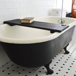 Wooden Tub Caddy in Black - Make a relaxing statement in your elegant bath with the Wooden Tub Caddy. Place a soothing candle, book, or glass of wine on the caddy and transform your soaking experience into something that you've always dreamed of. Made out of reclaimed oak from barns built in the 1800s, the caddy has two holes drilled in the corners—perfect for a votive candle or tea light. Water-resistant and easy to clean, the caddy just needs a quick wipe-down after every use.