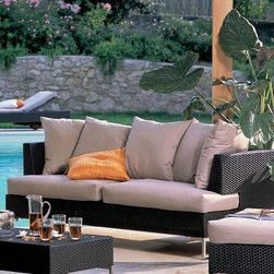 Outdoor Wicker Sofa in Brown - This outdoor wicker in brown wicker has matching chairs and coffee table.