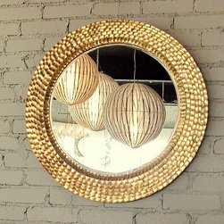 @ the shop - hand cut metal is gold leafed to make this wonderful mirror