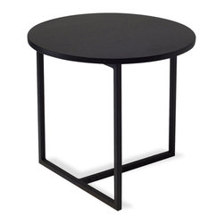 Bryght - Turner Black Round End Table - Sleek metal legs extend perpendicular to the wooden top creating an eclectic focal point. Combine the Turner end table with other tables from the Turner collection to create your own individual style
