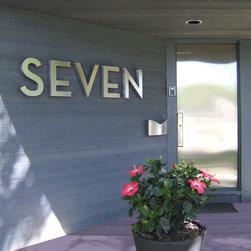 "SEVEN - Marine Grade (316) Stainless Neutraface Address Letters 14"" high by 2"" deep."