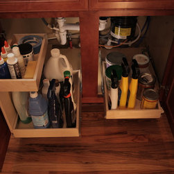 Kitchen Pull Out Shelves with Risers - Pull out shelves with risers are ideal for the cabinets under your sinks where pipes and garbage disposals lurk, eating up valuable storage room.  The riser adds a layer of storage that fits around the pipes inside the cabinet.