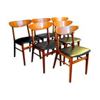 """Pre-owned 1950s Danish Modern Dining Chairs - Set of 6 - A great set of 6 teak back dining chairs. These are very similar in style to Hans Wegner Dining Chair CH-30.  These chairs came over from Denmark recently.  These are circa 1950's vintage. The chairs are sturdy with no loose joints. They feature their original black vinyl seats.  A few of the seats have some discoloration and a few small, small holes in the vinyl. They can be used """"as is"""" but they would be an easy update. The seats come off with a few screws, allowing them to be easily recovered in your favorite fabric. This is a classic Danish Design.    The seat is roughly 16 deep x 18 wide at the front, narrows a bit towards the rear....Backrest is 31"""" high from the floor and 20"""" wide with a curve... Seat is 17"""" off the floor."""