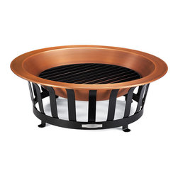 """Frontgate - Copper Fire Pit - Thick .8mm-gauge solid copper basin. Sturdy iron grate allows for a well-ventilated fire. Durable one-piece powdercoated steel base. Holds logs up to 2' long. Safety tested against extreme heat and weather. Our estate-quality 40"""" Copper Fire Pit is stylish and made to resist outdoor elements year-round. Don't be fooled by the painted, plated versions our competitors offer. Discover how The Frontgate Difference makes our substantial firepit outperform all others.  . . . . . Not approved for direct cooking uses. View safety instructions (PDF format)The Safety Sparkguard (sold separately) is crafted from high-heat painted stainless steel and is perfect to use around children; view instructions for use."""