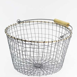 Wire Basket, Round - This basket reminds me of something you would find in Provencal France. It would be perfect for hauling in freshly-picked lavender or bounty from the garden. It has so many uses in the home — holding towels, throws, firewood or shoes!
