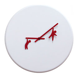 Progetti - Time2Play White/Red 2055 Wall Clock - The clock shows the will to interpret in an ironic and playful the passage of time bringing a bit of joy at any time of day. The little men clinging to the hands show their performance as circus trapeze artists. Made of wood. Battery quartz movement.