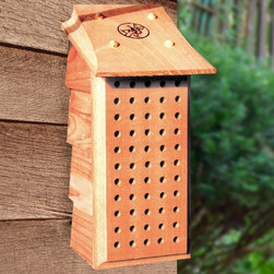 Schrodt - Mason Bee Lodge - Small, blue-black Mason bees are nature's mild mannered, peaceful pollinators that bring bountiful harvest to gardens and orchards. They need existing holes to nest in, and since they don't have a queen to protect, they rarely sting. Their only mission is