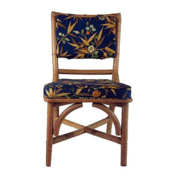 Pre-owned Bamboo Garden Style Dining Chairs - Set of 6 - We are enamored by this bamboo dining chair sets sleek lines and unusually sturdy weight. These chairs have great bones, and while we like the garden style upholstery, they could easily be reupholstered for a more chic look.