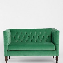 Plum & Bow Tufted Settee, Dark Green - This is the perfect small seating option for a corner area of an open space. I love how the green adds a punch of color, making the room more playful.