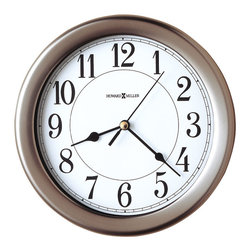 """Howard Miller - Brushed Nickel 12 Hour Wall Clock with Lockin - Enjoy this simple and yet charming brushed nickel wall clock in any contemporary setting. The clock itself has a clean white dial and bold black Arabic numerals. The black hour and minute hands sport a classic spade arrow design, and it has a black second hand also. The back plate twists off for easy 3-point screw mounting. * This brushed nickel-finished wall clock coordinates with today's latest interior styles. . Behind the glass crystal, the white dial features black Arabic numerals, black spade hour and minute hands, and a black second hand. . The locking rear cover twists off for easy mounting. . Brushed nickel finish. . Quartz, battery operated movement. . D. 1-1/2"""" (4 cm). Dia. 8-1/2"""" (27 cm)"""