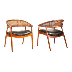 Mid-Century Danish Cane Back Accent Chairs - An Edward Wormley style pair of Danish Mid-Century chairs, made in Spain (stamped). The pair features solid wood construction - these are a high end designer chair set, believed to be made of Rosewood. Features a rounded cane back and dramatic splayed Danish style legs. Newly reupholstered black naugahyde seats, to boot!