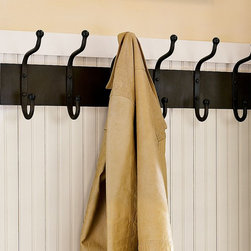 "Cast Iron Row of Hooks - Use this handsome row of hooks for coats, scarves, hats and umbrellas, or get creative and use it to display your necklaces within easy reach.Panel is crafted of cast iron with a bronze finish.Features 6 oversized hooks.Mounting hardware included.32"" wide x 5"" deep x 10"" high"