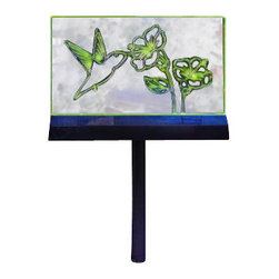 Coleman Cable - Humming Bird Garden Sign - MOONRAYS Hummingbird Garden Sign. Popular hummingbird design glows at night to add interest to your garden. Use with included ground stake or place on tabletop. 2 x Green LEDs, AA NiCd rechargeable battery included. Clear plastic sign with black ground stake. Runs up to 8 hours on a full charge. 1 garden sign per color box.