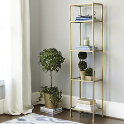 Ballard Designs - Chloe Narrow Etagere - Light, airy design. Hand applied brass finish. Fully assembled. Use one alone or pair them flanking our Chloe Wide Etagere to create a wall of storage. Frame is crafted of steel and features four clear glass shelves for displaying books, porcelains or try it in the bath for towels and toiletries. Chloe Etagere features: . . .