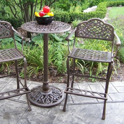 Oakland Living Mississippi 3 Piece Outdoor Pub Set - Southern hospitality rises to new heights with the Mississippi 3 Piece Outdoor Pub Set. These two barstools with matching table create a charming spot perfect for enjoying drinks or having an intimate meal. The top of the Mississippi table is patterned with serpentine scrolls along the outer rim and a lattice in the center. The matching bar stools have the same scroll pattern on the chair backs with comfortable and durable lattice seats. The Mississippi 3 Piece Bar Set is as durable as it looks. Constructed of solid cast aluminum this set is built to withstand strong winds and outdoor elements. The metal is designed not to rust and features stainless steel fastening hardware for assembly. The table also has an umbrella hole to accommodate a 1.5 inch diameter pole. Notes on assembly: Seat and arm rests are welded as one unit. Legs back and foot rests require assembly. Assembly requires only two tools: a Phillips screwdriver and a wrench. Estimated time of assembly for the whole set is 60 minutes. Item shown above in Antique Bronze.