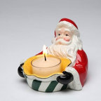 CG - Santa Claus Holding Green and White Striped Tea Light Candle Holder - This gorgeous Santa Claus Holding Green and White Striped Tea Light Candle Holder has the finest details and highest quality you will find anywhere! Santa Claus Holding Green and White Striped Tea Light Candle Holder is truly remarkable.