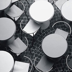 """Kartell - Dr. Glob Chair - The interplay between thickness and lightness characterizes the Dr. Glob series, which makes use of steel and polypropylene to obtain structural rigidity and eye-catching contrast. Along with Miss Global, Dr. Glob was the first chair produced in plastic with angular lines. The seat of the Dr. Glob Chair, made of a special plastic compound to create a warm, soft, opaque quality, is attached to a steel backrest that prolongs the structure of the rear support legs. The Dr. Glob series is versatile and built to last, stackable up to ten chairs high and suitable for the outdoors. This Dr. Glob Chair is a wonderful piece for design enthusiasts who seek durability and practicality in addition to style. Designed by: Philippe Starck, 1991 Features at a Glance: Dr. Glob Chair Features: -Frame made of epoxy-polyester powder coated steel. -Seat made of bulk-dyed polypropylene. -Batch-dyed to resist abrasion and extend product life. -Stackable up to ten chairs high. -Can be used indoors or outdoors. -Made in Italy. Dimensions: -28.75"""" H X 19"""" W X 18.75"""" D. -Seat Height: 18"""". Quality: -In 2005, Kartell received accreditation for its Quality Management Systems according to the ISO 9001: 2000 standard. The attainment and preservation of this certification testifies to Kartell's commitment to high quality and continued research into higher levels of quality in company management systems. Helping the Environment: -Kartell products use a wide variety of plastic materials, thereby reducing the use of living organisms, such as trees, which are difficult and time-consuming to replace. -Most Kartell products are easily recycled and product components can be separated to elements made of a single material to simplify the recycling process. Plastic components also carry clear identification marks to aid correct separation of different plastic types for effective recycling. Care and Maintenance: -Kartell products are easy to clean and require only simple care to re"""