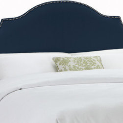 """Skyline Furniture - Nail Button Upholstered Headboard - This antique styled headboard is upholstered in luxurious linen and is embellished with an ornamental nail button trim. Its curvaceous silhouette, makes this headboard a showpiece of any bedroom. Attaches to any standard bed frame. Features: -Nail Button collection. -Solid pine frame. -Metal legs. -Polyurethane and polyester fill foam. -Handmade. -Spot clean only. -1 Year limited warranty; excludes fabric. -Made in the USA. Dimensions: -Twin: 54"""" H x 41"""" W x 4"""" D, 24 lbs. -Full: 54"""" H x 56"""" W x 4"""" D, 31 lbs. -Queen: 54"""" H x 62"""" W x 4"""" D, 33 lbs. -King: 54"""" H x 78"""" W x 4"""" D, 45 lbs. -California King: 54"""" H x 74"""" W x 4"""" D, 40 lbs."""