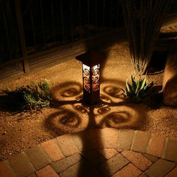 Bollards - This is the swirl pattern from our 4x4 series of decorative steel bollard lights.  A great accent for traditional and contemporary settings.  The patterns are amazing as they transfer to the surrounding landscape and ground.  These lights make a wonderful accent along pathways or as stand alone pieces of steel garden art in the landscape.  The natural rust finish makes them blend and harmonize with the landscape by day and they steal the show at night.  These truly are functional garden art.