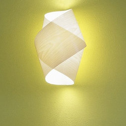 Global | LZF - Orbit wall sconce - The Orbit wall sconce has been designed by Miguel Herranz for LZF Lighting. ORBIT is a hand made wall lamp whose wood veneer screen is interlaced creating an elegant intertwined silhouette. On the one hand the simplicity of its design confers an airy appearance and on the other hand, the veneer confers a pleasantly warm aspect to the design.