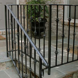 Decorative Handrail and Flagstone Patio - Designed and built by Land Art Design, Inc.