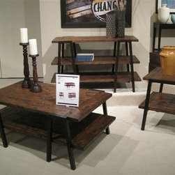 Magnussen Furniture - Lawton 3-Pc Occasional Table Set - Includes cocktail table, sofa table and end table. Mission style. 0.98 in. solid pine top. Cocktail table and end table with one bottom shelf. Sofa table with two shelves. Rustic iron tube legs. Wipe with a damp cloth and use a mild soap. Warranty: One year limited. Made from pine veneers with pine solids. Rustic natural pine finish. End table: 22 in. W x 24 in. D x 24 in. H (44 lbs.). Cocktail table: 50 in. W x 30 in. D x 19 in. H (73 lbs.). Sofa table: 50 in. W x 20 in. D x 29 in. H (79 lbs.)Artist�۪s retreat meets contemporary in the graphically styled Lawton. Be careful when using commercial cleaners and follow all manufacturer instructions, test them on a small inconspicuous area first. Do not use chemical cleaners or glass cleaners on finish as they may break down the finish.